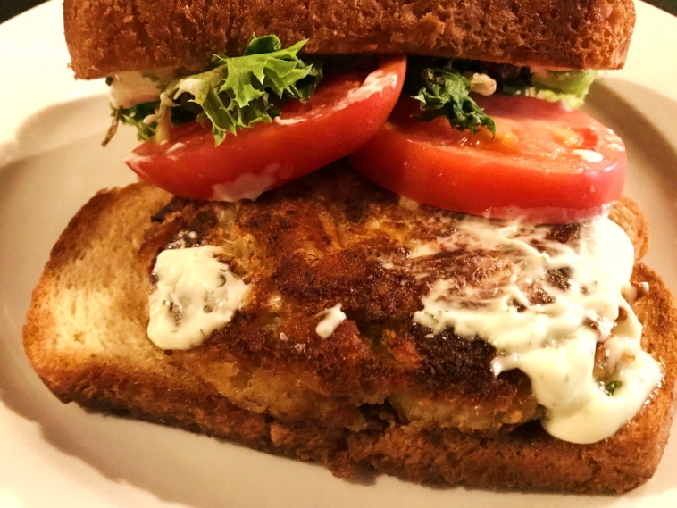 Crab cake Sandwich Served with Lettuce, Tomato, and Lemon Dill Aioli